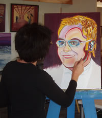 Giselle paints Elton John's Portrait